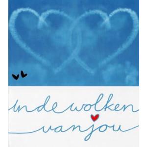 valentijnskaart in de wolken van jou blauwe lucht met vliegtuigstrepen