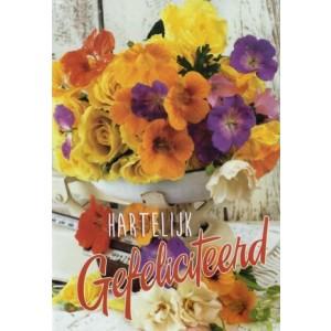 Felicitatiekaart met mooie fleurige bloemen op een weegschaal