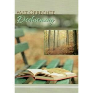 Condoleance wenskaart kleur met een openliggend boek op een bankje in het bos.