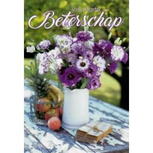 Beterschapskaart met bloemen en fruit op een tuintafel