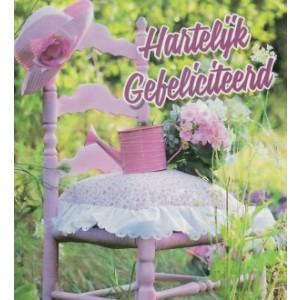 wenskaart met een roze stoel enbloemen en tekst hartelijk gefeliciteerd